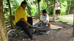 Stock Video Footage of American Samoa villagers roasting cacao beans 4k