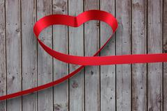 Stock Illustration of Large red ribbon in a heart shape