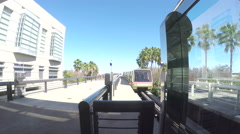 4K of Orlando airport tram pulling in to station. Stock Footage