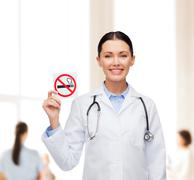 Smiling female doctor with stethoscope Stock Photos