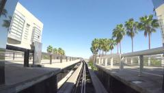 4K POV of tram going to airport terminal time lapse Stock Footage