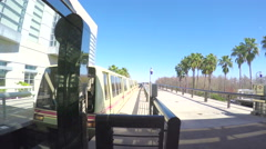 4K Orlando airport tram pulling in to station Stock Footage