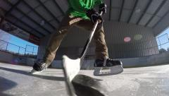 Hockey player shoots and stickhandles the puck Stock Footage