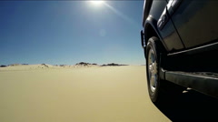 P.O.V four wheel drive driving on sand beach Stock Footage