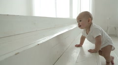 Baby crawling on the stairs Stock Footage