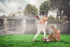 Composite image of angry woman attacking partner with rose bouquet Stock Photos