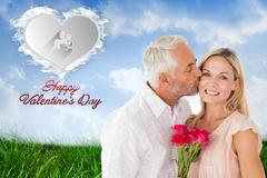 Composite image of affectionate man kissing his wife on the cheek with roses Stock Illustration