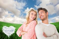 Stock Illustration of Composite image of attractive couple smiling with arms crossed