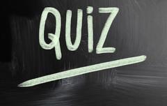 Quiz handwritten with chalk on a blackboard Stock Photos