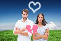 Stock Illustration of Composite image of upset couple holding two halves of broken heart
