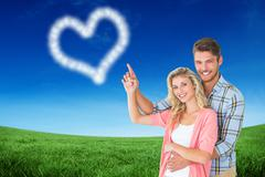 Composite image of attractive young couple embracing and pointing Stock Illustration