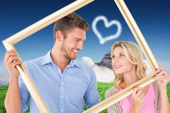 Composite image of attractive young couple holding picture frame - stock illustration
