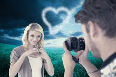 Stock Illustration of Composite image of man taking photo of his pretty girlfriend