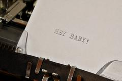 Text Hey Baby typed on old typewriter - stock photo