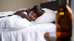 Little sick boy sleeping in bed Stock Footage