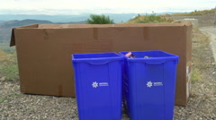 The environment, man recycle with blue bins, wide shot Stock Footage