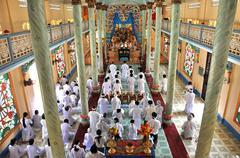 Adherents to Cao Dai religion praying in Vietnam Stock Photos