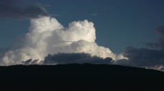 Time-lapse, long duration evening cloud over mountain into night Stock Footage
