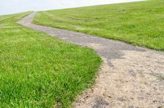 Walkway on a dyke. - stock photo