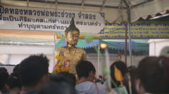 Golden Buddha statue people crowded Stock Footage