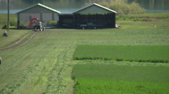 Agriculture, enclosed tractor harvesting, very green, turn around Stock Footage