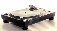 DJ Turntable. Dropping the needle on a spinning vinyl record player Stock Footage
