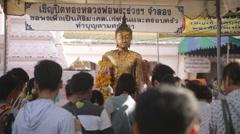 Golden Buddha statue Thai people  Stock Footage