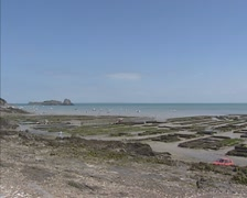 CANCALE, FRANCE -  pan Rocher de Cancale, marina and oyster beds at low tide Stock Footage