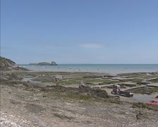 CANCALE, FRANCE - Rocher de Cancale, marina and oyster beds at low tide Stock Footage