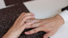 Putting wedding rings on Stock Footage
