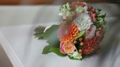Color wedding bouquet at table Stock Footage