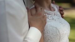 Groom embraces the bride's shoulders Stock Footage