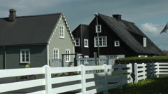 Iceland provincial regions Eyrarbakki village 005 wooden houses and white fence - stock footage