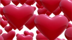 Red hearts flying up.Seamless loop Stock Footage