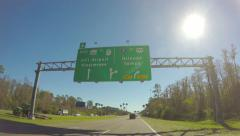 4K driving under Orlando AIroprt, Tampa, Interstate 4 sign Stock Footage