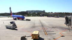 Stock Video Footage of Reversed time lapse to appear Southwest jet is pulling into gate