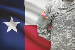 American soldier with flag on background - Texas Kuvituskuvat