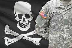 American soldier with flag on background - Jolly Roger - symbol of piracy Stock Photos