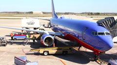 Southwest food truck pulling up to plane Stock Footage