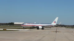 Slow motion sun flare off the paint of an American Airlines plane Stock Footage
