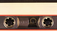 Stock Video Footage of Cassette Tape with a white blank label
