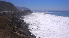 Large waves crash along a California beach near Malibu. Stock Footage