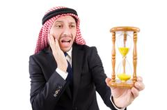 Stock Photo of Arab man thinking about passage of time