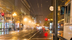 Time lapse of a rainy San Francisco morning at Market st. Stockton and Ellis Stock Footage