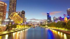 Timelapse video of Melbourne from sunset to night, zooming in Stock Footage