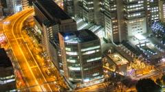 Night time lapse taken in Shinjuku Tokyo Japan looking west from a high vantage Stock Footage