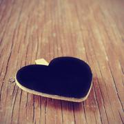 blank heart-shaped chalkboard on a rustic wooden surface, with a filter effec - stock photo