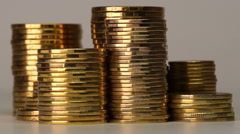 Several Columns of Coins Spinning Stock Footage