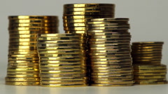 Several Columns of Coins Spinning - stock footage