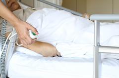 Women pressing emergency nurse call button Stock Photos